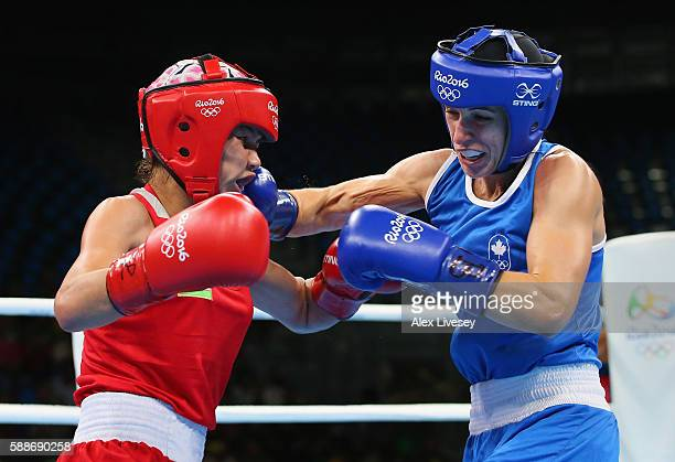 Mandy Bujold of Canada lands a right shot on Yodgoroy Mirzaeva of Kazakhstan during the Women's Flyweight Preliminaries on Day 7 of the 2016 Rio...