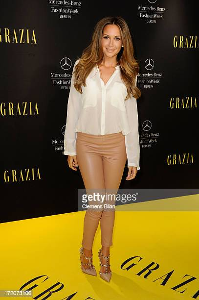 Mandy Capristo attends the MercedesBenz Fashion Week Berlin Spring/Summer 2014 Preview Show by Grazia at the Brandenburg Gate on July 1 2013 in...