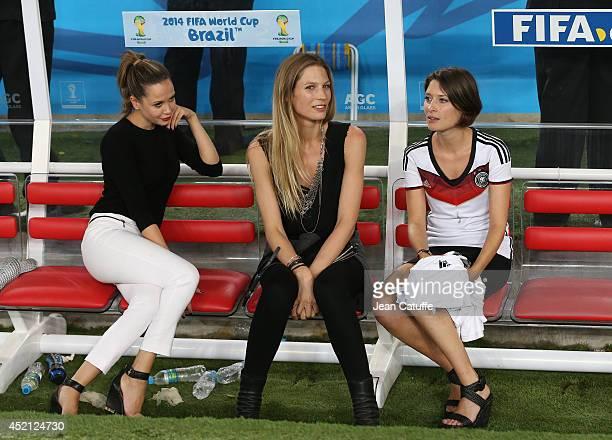 Mandy Capristo, girlfriend of Mesut Ozil, Sarah Brandner, girlfriend of Bastian Schweinsteiger, Kathrin Glich, girlfriend of Manuel Neuer celebrate...