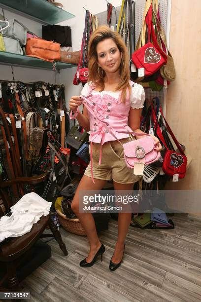 Mandy Capristo member of the girl band Monrose poses during shopping at Trachtenmode Angermaier a shop for traditional Bavarian clothes on October 1...