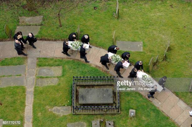Mandy Carter follows the funeral cortege of her three children Samantha Patricia and Marcus Carter as it arrives at St Edward's Church in Leek...