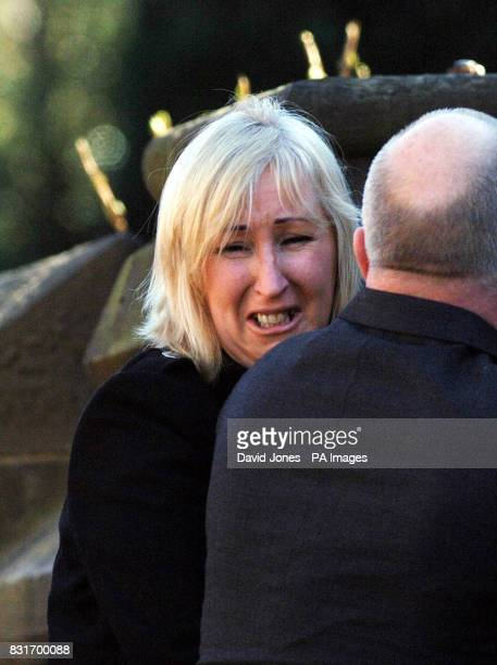 Mandy Carter looks back at her partner Roddy Hine's Suzuki motorbike as his coffin is carried into All Saints Church Leek Staffordshire Tuesday April...