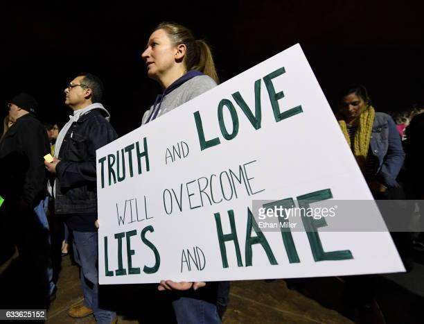 Mandy Enerson of Nevada attends a vigil outside Nevada Republican Sen Dean Heller's office on February 2 2017 in Las Vegas Nevada The vigil was held...