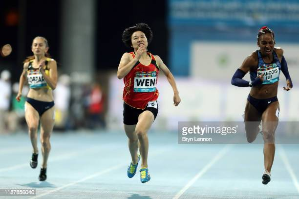 Mandy Francois-Elie of France competes against Xiaoyan Wen of China after the Women's 200m T37 during Day Nine of the IPC World Para Athletics...