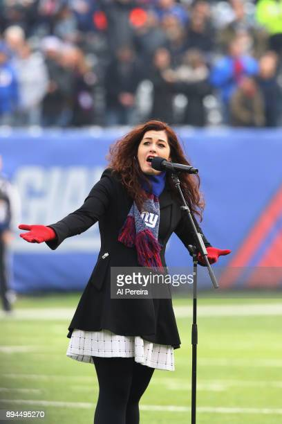 Mandy Harvey performs The National Anthem at the Philadelphia Eagles vs New York Giants game at MetLife Stadium on December 17 2017 in East...
