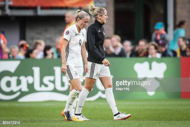 Mandy Islacker and Kathrin Hendrich of Germany react after the UEFA Women's Euro 2017 Quarter Final match between Germany and Denmark at Sparta...