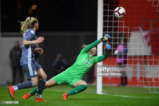 Mandy Islacker of Bayern Munich scores her teams's fourth goal against Barbora Votikova of Slavia Prague during the UEFA Women's Champions League...