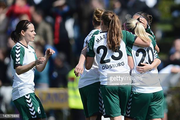 Mandy Islacker of Duisburg celebrates with teammates after scoring her team's first goal during the Women's DFB Cup semi final match between 1. FFC...