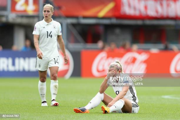 Mandy Islacker of Germany and Anna Blasse of Germany are dejected after the UEFA Women's Euro 2017 Quarter Final match between Germany and Denmark at...