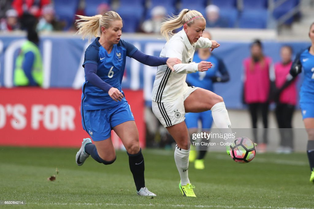 Mandy Islacker #15 of Germany challenged by Amadine Henry #6 of France during the France Vs Germany SheBelieves Cup International match at Red Bull Arena on March 4, 2017 in Harrison, New Jersey.