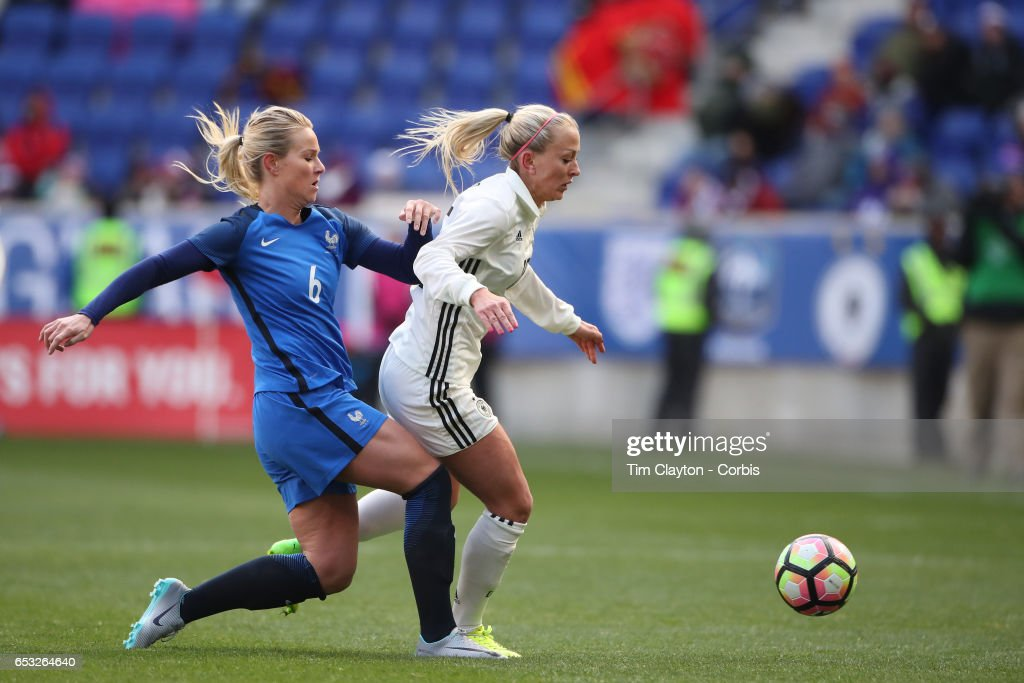 Mandy Islacker #15 of Germany is challenged by Amadine Henry #6 of France during the France Vs Germany SheBelieves Cup International match at Red Bull Arena on March 4, 2017 in Harrison, New Jersey.