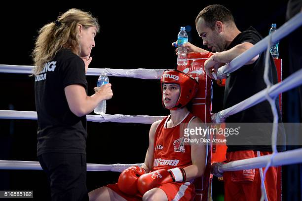 Mandy Marie Brigitte Bujold of Canada receives instructions from her coach during the Women´s Fly category as part of American Olympic Qualification...