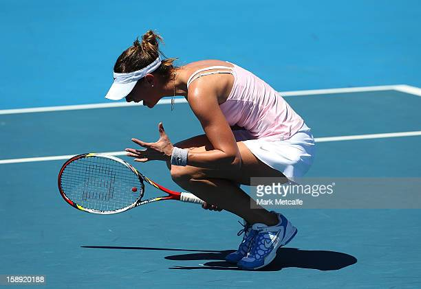 Mandy Minella of Luxembourg reacts to losing a point in her qualifying singles match with Rebecca Marino of Canada during day one of the Hobart...