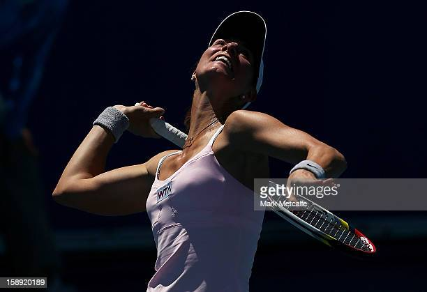 Mandy Minella of Luxembourg serves in her qualifying singles match with Rebecca Marino of Canada during day one of the Hobart International at Domain...