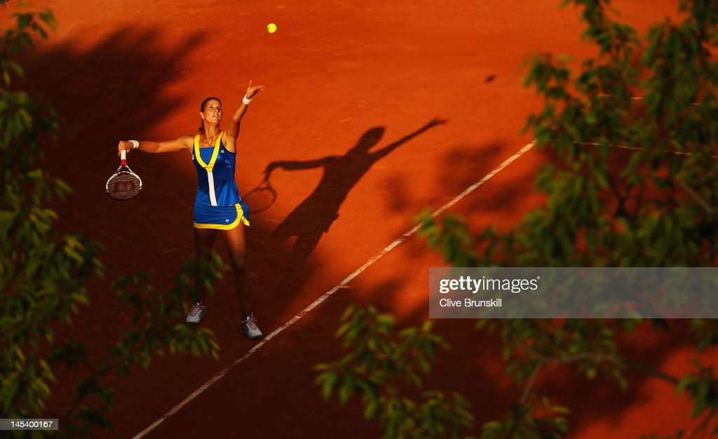 Mandy Minella of Luxembourg serves in the women's singles first round match between Yaroslava Shvedova of Kazakhstan and Mandy Minella of Luxembourg during day two of the French Open at Roland Garros on May 28, 2012 in Paris, France.