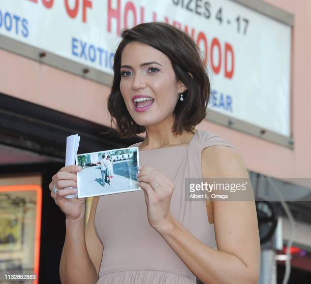 Mandy Moore displays a photo of herself and costar Shane West during her star ceremony on The Hollywood Walk of Fame on March 25 2019 in Hollywood...