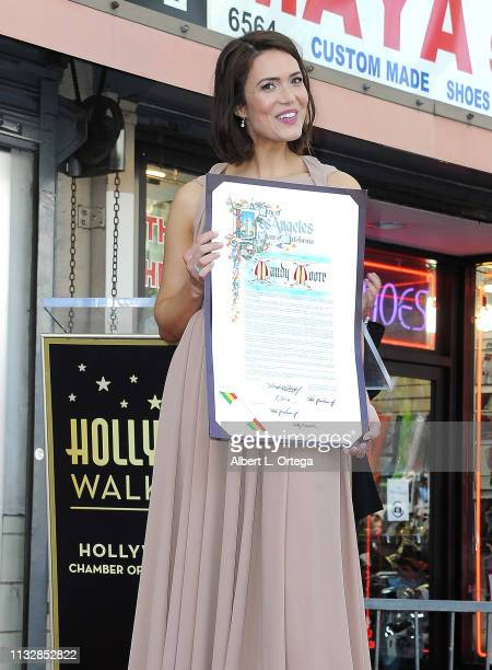 Mandy Moore displays a proclamation from the Los Angeles City Council during her star ceremony on The Hollywood Walk of Fame on March 25 2019 in...