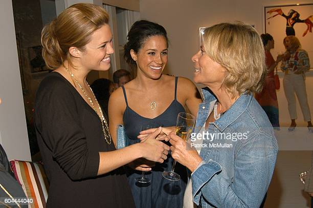 Mandy Moore Meghan Markle and Sandy Gross attend COACH Legacy Photo Exhibit by REED KRAKOFF at Coach on August 26 2006 in East Hampton NY