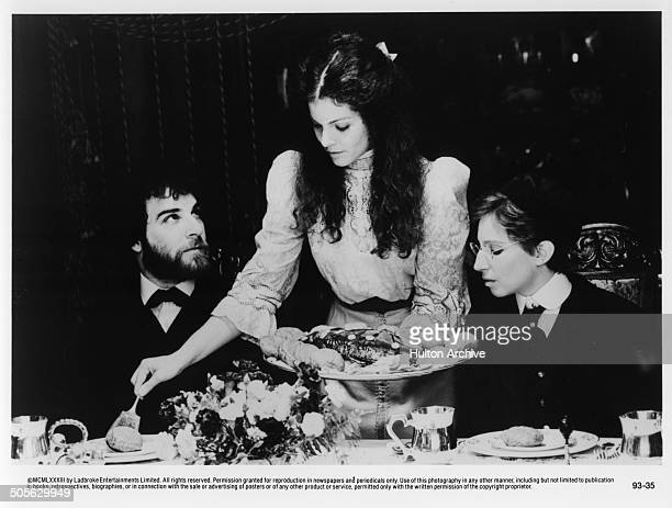 Mandy Patinkin Amy Irving and Barbra Streisand at a dinner table in a scene in the movie 'Yentl' circa 1983