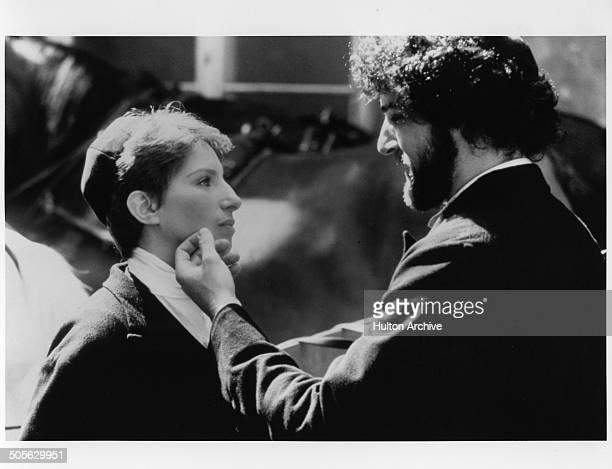 "Mandy Patinkin says goodbye to Barbra Streisand in a scene in the movie ""Yentl"" circa 1983."