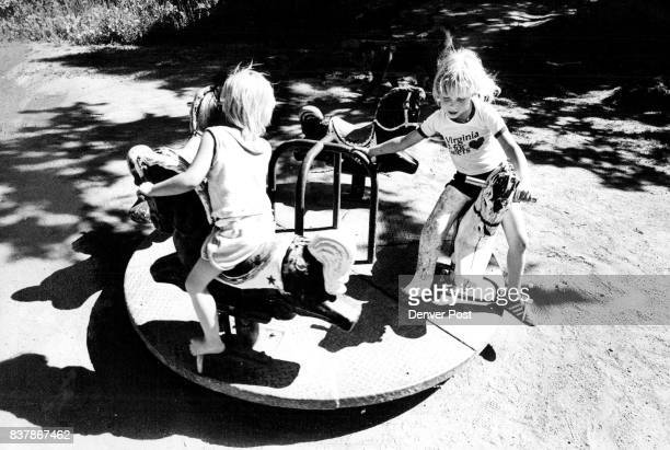 Mandy Peterson left 3 1/2 and Amber Peterson ***** the playground in Chatagua Park in Boulder Credit The Denver Post