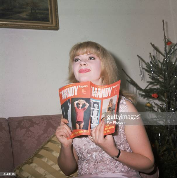 Mandy RiceDavies holding her book about the Profumo affair'The Mandy Report'