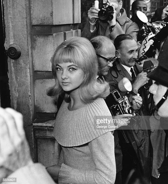 Mandy RiceDavies Welsh born model and showgirl surrounded by press photographers during Stephen Ward's court case in the Profumo affair