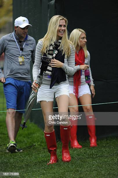Mandy Snedeker wife of Brandt Snedeker and Dowd Simpson wife of Webb Simpson of the US Team follow the play during the Day Three FourBall Matches of...