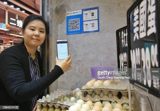 Mandy Sze Owner of 228 shows merchant quick response code and payment instructions for Ant Financial Services Group's Alipay are displayed at her...