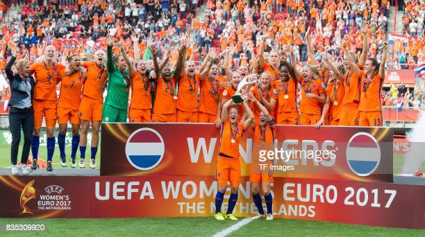 Mandy Van Den Berg and Sherida Spitse of Netherlands Women lift the trophy as their team mates celebrate after the UEFA Women's Euro 2017 final match...