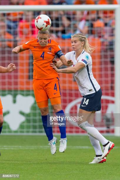 Mandy van den Berg of the Netherlands and Ada Hegerberg of Norway battle for the ball during their Group A match between Netherlands and Norway...