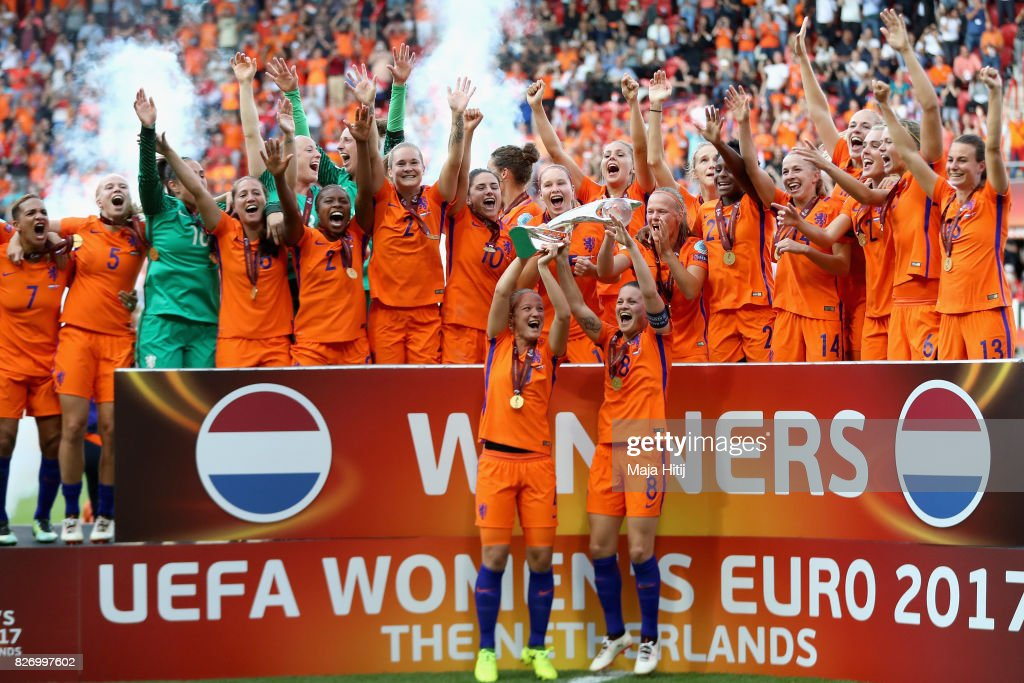 Mandy van den Berg of the Netherlands and Sherida Spitse of the Netherlands lift the trophy following the Final of the UEFA Women's Euro 2017 between Netherlands v Denmark at FC Twente Stadium on August 6, 2017 in Enschede, Netherlands.
