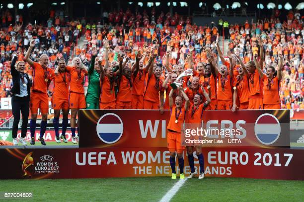 Mandy van den Berg of the Netherlands and Sherida Spitse of the Netherlands lift the trophy following the Final of the UEFA Women's Euro 2017 between...