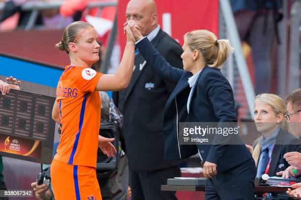 Mandy van den Berg of the Netherlands shakes hands with Head coach Sarina Wiegman of the Netherlands during their Group A match between Netherlands...
