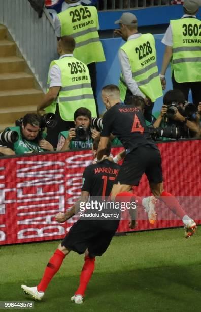Mandzukic of Croatia celebrates with his teammate Perisic after scoring a goal during the 2018 FIFA World Cup Russia semi final match between Croatia...