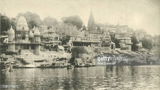 Manekanka Bathing and Burning Ghat, Benares'. View of the Manikarnika ghat and temples on the River Ganges at Varanasi, Uttar Pradesh, India. The...