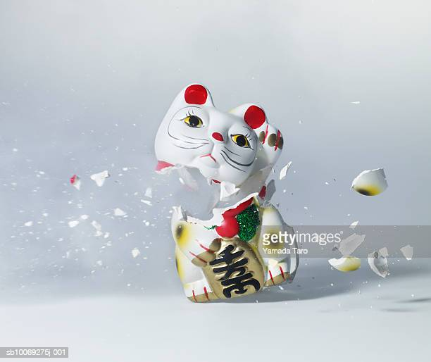 Maneki Neko exploding, close-up