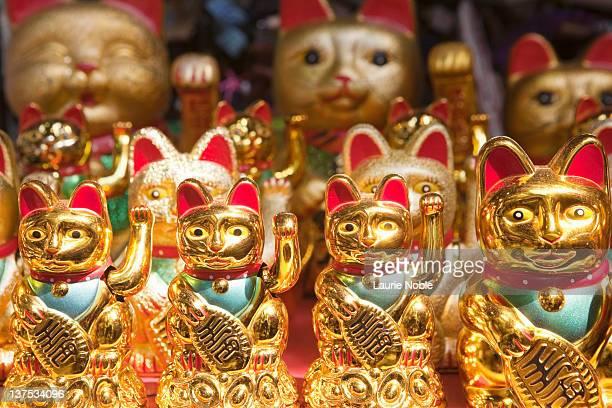 maneki neko; waving cat for sale; yuyuan bazaar - dolly golden stock pictures, royalty-free photos & images