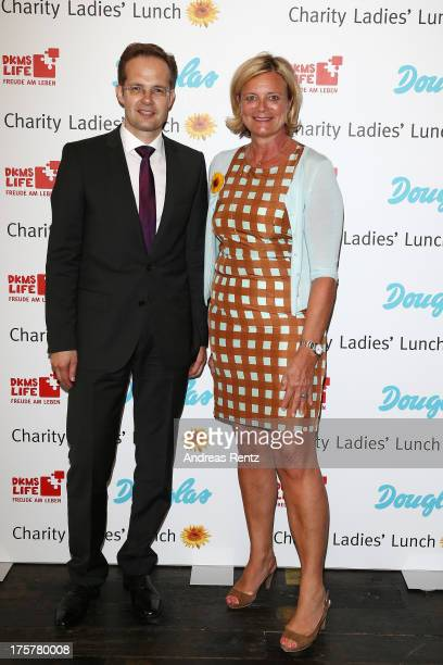 Manfred Kroneder and Claudia Rutt attend the DKMS LIFE Charity Ladies lunch at Soho House on August 8 2013 in Berlin Germany