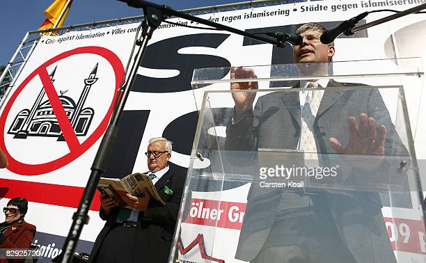 Manfred Rouhs chief executive officer of the far right Pro Koeln in the cologne city parliament speaks beside Mario Borghezio member of european...