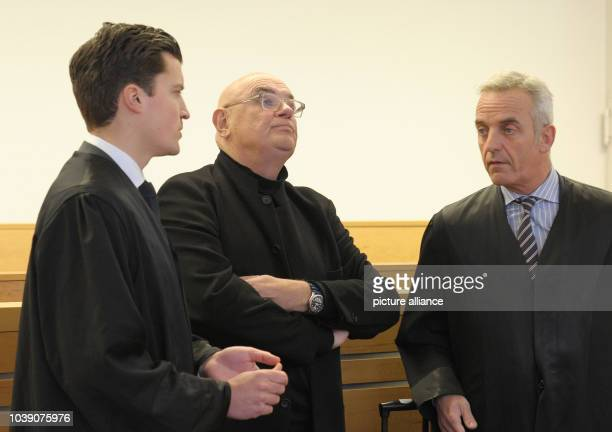 Manfred Schmidt stands in a courtroom next to his lawyers Markus Twele and Daniel M Krause at the regional court in Hanover Germany 17January 2014...