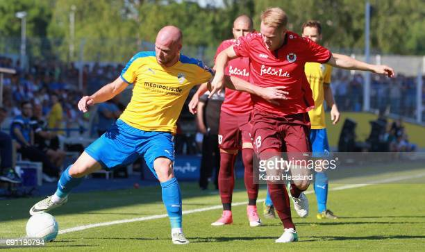 Manfred Starke of Jena challenges Lukas Nottbeck of Koeln during the Third League Playoff Leg Two between FC Carl Zeiss Jena and Viktoria Koeln on...