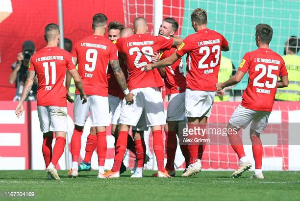 Manfred Starke of Kaiserslautern celebrates his team's first goal with team mates during the DFB Cup first round match between 1 FC Kaiserslautern...
