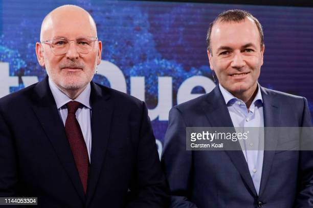 Manfred Weber lead candidate for the European Peoples' Party and Frans Timmermans lead candidate of the European Socialists pose for the media before...