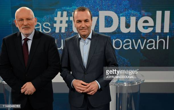 Manfred Weber top candidate of the European People's Party and Frans Timmermans top candidate of Party of European Socialists pose for photographers...