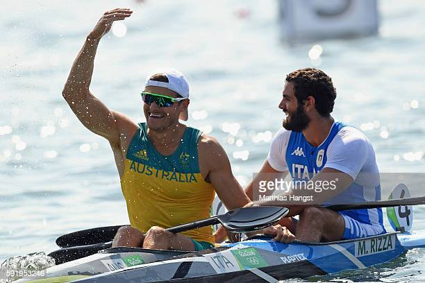 Manfredi Rizza of Italy and Stephen Bird of Australia react after competeing in the Men's Kayak Single 200m on Day 14 of the Rio 2016 Olympic Games...