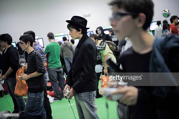 Manga and Anime fans play with a Nintendo Xbox 360 during the XVI Manga Fair in Hospitalet on October 29 2010 near Barcelona Spain