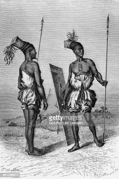 Mangbetu or Monbuttu warriors illustration from Journey to Monbuttu in Searching for the source of the Nile and in the heart of Africa Treves Edition...
