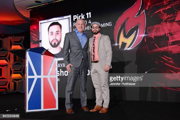 Manging Director of the NBA2K League Brendan Donohue poses for a photo with Carlos ZayasDiaz aka sharpshooterlos after being selected during the...
