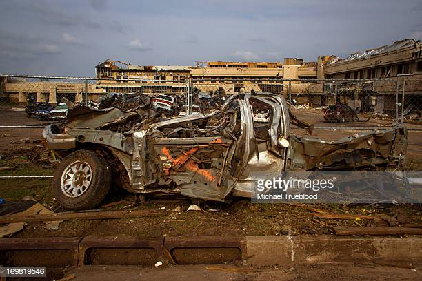Mangled car sits before the destruction of Moore Medical Center after tornado hit Moore, Oklahoma on May 20, 2013.